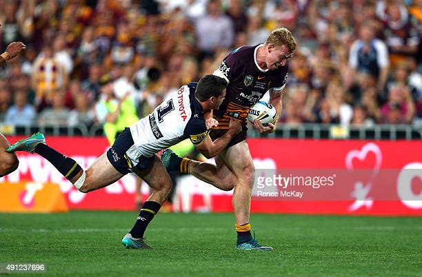 Jack Reed of the Broncos scores a try in the tackle of Lachlan Coote of the Cowboys during the 2015 NRL Grand Final match between the Brisbane...