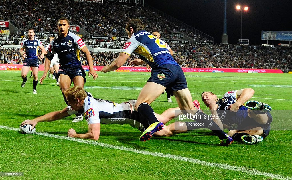 Jack Reed of the Broncos scores the second try of the match during the round 23 NRL match between the North Queensland Cowboys and the Brisbane Broncos at Dairy Farmers Stadium on August 12, 2011 in Townsville, Australia.