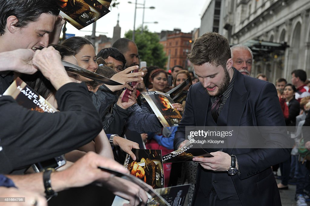 <a gi-track='captionPersonalityLinkClicked' href=/galleries/search?phrase=Jack+Reynor&family=editorial&specificpeople=10130487 ng-click='$event.stopPropagation()'>Jack Reynor</a> greets fans at the Irish Premiere of 'Transformers 4: Age of Extinction' at Savoy Cinema on July 3, 2014 in Dublin, Ireland.