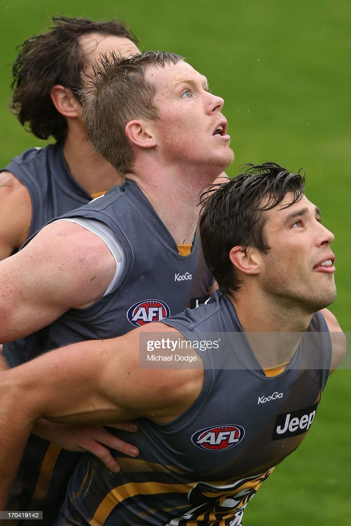 Jack Riewoldt (C) Alex Rance (R) and Ben Griffiths contest for the ball during a Richmond Tigers AFL training session at ME Bank Centre on June 13, 2013 in Melbourne, Australia.