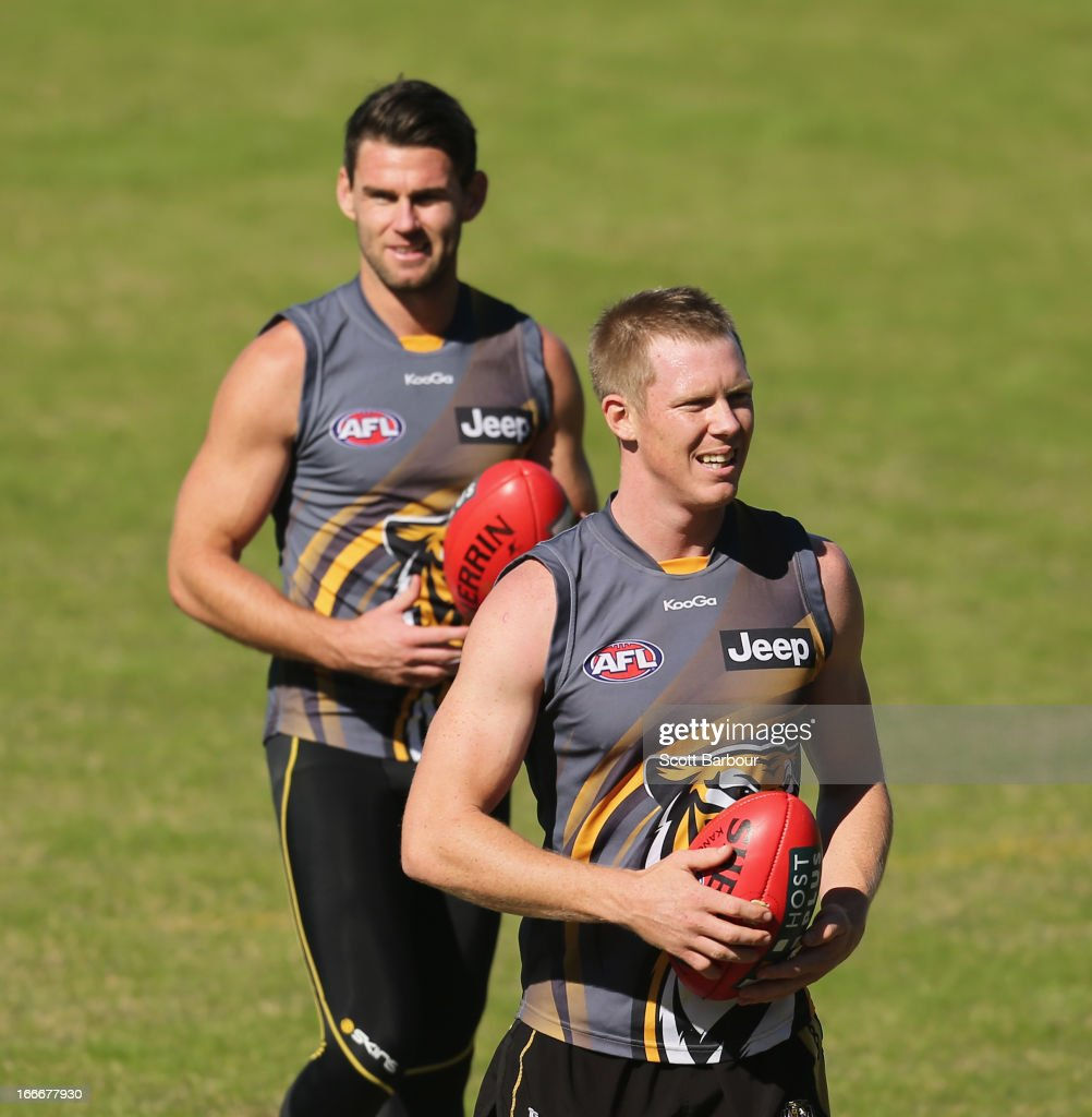 Jack Riewoldt and Chris Newman of the Tigers run with the ball during a Richmond Tigers AFL training session at ME Bank Centre on April 16, 2013 in Melbourne, Australia.