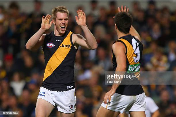 Jack Riewoldt and Trent Cotchin of the Tigers celebrate a goal during the round ten AFL match between the West Coast Eagles and the Richmond Tigers...