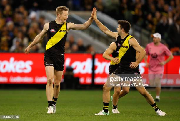 Jack Riewoldt and Trent Cotchin of the Tigers celebrate during the 2017 AFL round 14 match between the Richmond Tigers and the Carlton Blues at the...