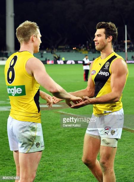 Jack Riewoldt celebrates with Alex Rance of the Tigers after defeating the Power during the round 15 AFL match between the Port Adelaide Power and...