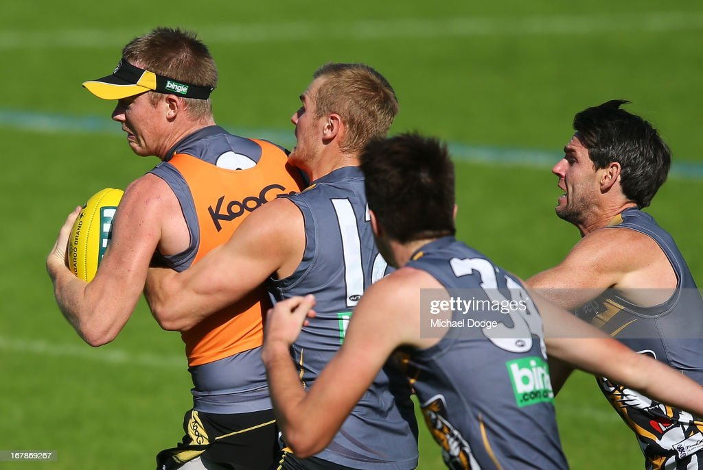 Jack Riewoldt (L) gets tackled by David Astbury during a Richmond Tigers AFL training session at ME Bank Centre on May 2, 2013 in Melbourne, Australia.