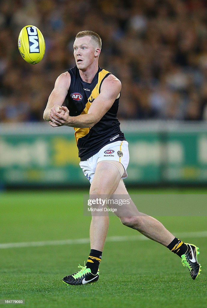 A Jack Riewoldt handpasses the ball during the round one AFL match between the Carlton Blues and the Richmond Tigers at Melbourne Cricket Ground on March 28, 2013 in Melbourne, Australia.