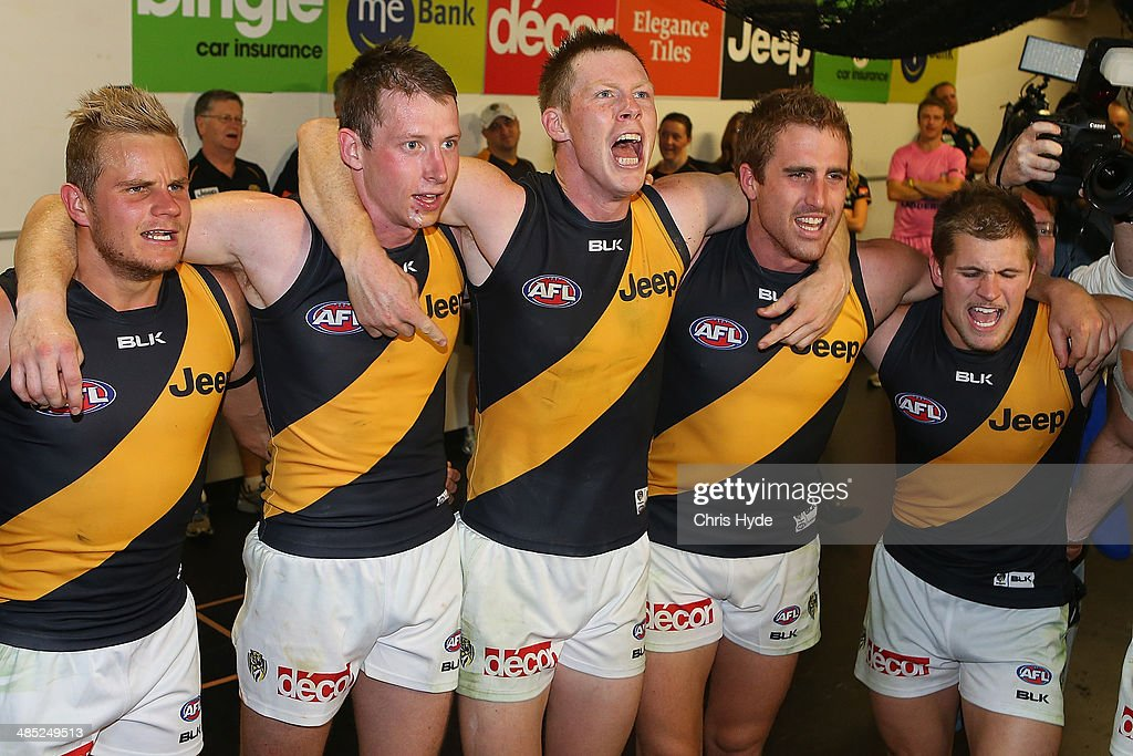 <a gi-track='captionPersonalityLinkClicked' href=/galleries/search?phrase=Jack+Riewoldt&family=editorial&specificpeople=2327975 ng-click='$event.stopPropagation()'>Jack Riewoldt</a> leads the Tigers team song after winning the round five AFL match between the Brisbane Lions and the Richmond Tigers at The Gabba on April 17, 2014 in Brisbane, Australia.
