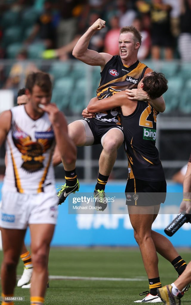<a gi-track='captionPersonalityLinkClicked' href=/galleries/search?phrase=Jack+Riewoldt&family=editorial&specificpeople=2327975 ng-click='$event.stopPropagation()'>Jack Riewoldt</a> of the Richmond Tigers celebrates his winning goal after the final siren with Ben Griffiths during the round three NAB Cup AFL match between the Hawthorn Hawks and the Richmond Tigers at Aurora Stadium on March 9, 2013 in Launceston, Australia.