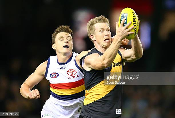 Jack Riewoldt of the Richmond Tigers takes a mark as he is tackled by Jake Lever of the Adelaide Crows during the round three AFL match between the...