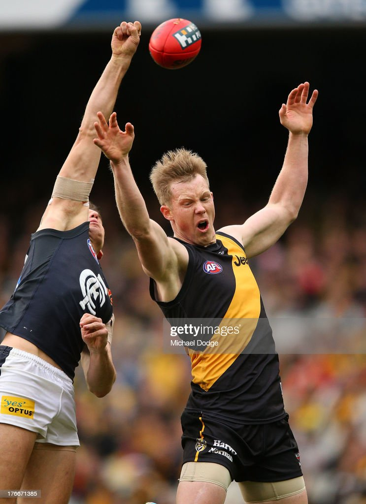 <a gi-track='captionPersonalityLinkClicked' href=/galleries/search?phrase=Jack+Riewoldt&family=editorial&specificpeople=2327975 ng-click='$event.stopPropagation()'>Jack Riewoldt</a> (R) of the Tigers and Michael Jamison of the Blues contest for the ball during the round 21 AFL match between the Richmond Tigers and the Carlton Blues at Melbourne Cricket Ground on August 17, 2013 in Melbourne, Australia.