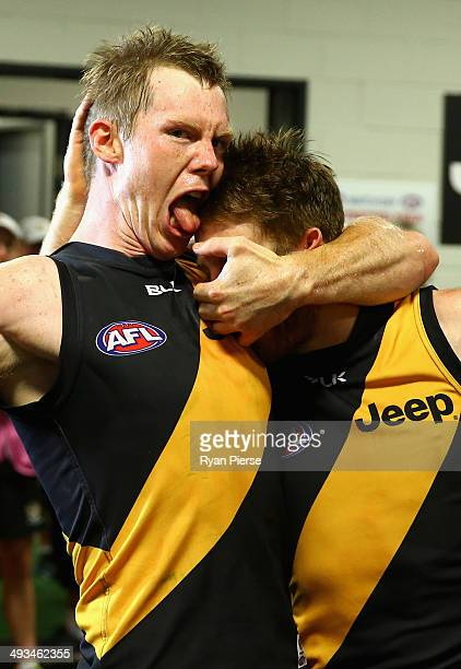 Jack Riewoldt of the Tigers and Reece Conca of the Tigers celebrate after the round 10 AFL match between the Greater Western Sydney Giants and the...