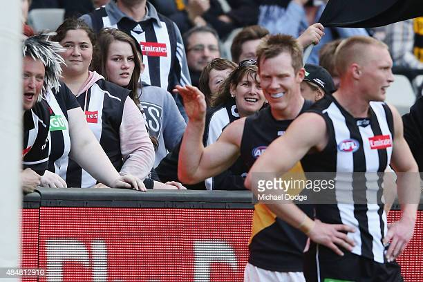 Jack Riewoldt of the Tigers baits the Magpies cheersquad after he kicks a goal during the round 21 AFL match between the Collingwood Magpies and the...