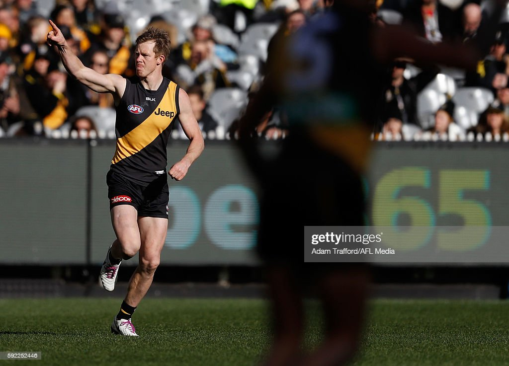 Jack Riewoldt of the Tigers celebrates a goal during the 2016 AFL Round 22 match between the Richmond Tigers and the St Kilda Saints at the Melbourne...