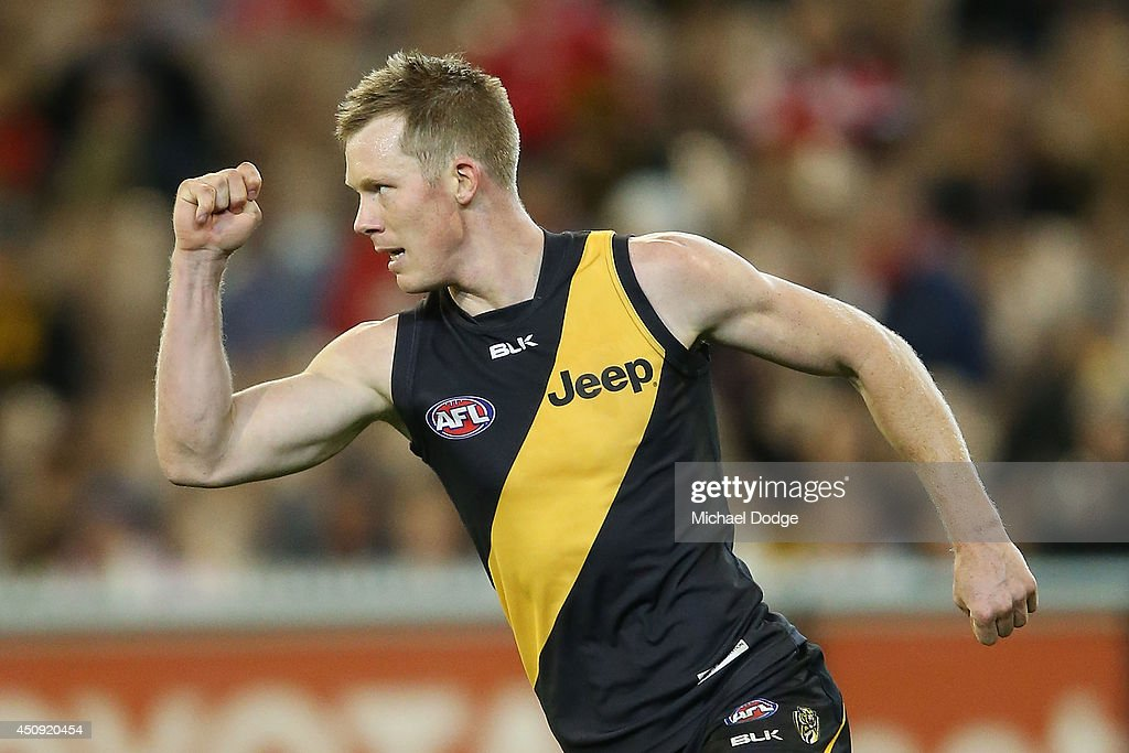<a gi-track='captionPersonalityLinkClicked' href=/galleries/search?phrase=Jack+Riewoldt&family=editorial&specificpeople=2327975 ng-click='$event.stopPropagation()'>Jack Riewoldt</a> of the Tigers celebrates a goal during the round 14 AFL match between the Richmond Tigers and the Sydney Swans at Melbourne Cricket Ground on June 20, 2014 in Melbourne, Australia.