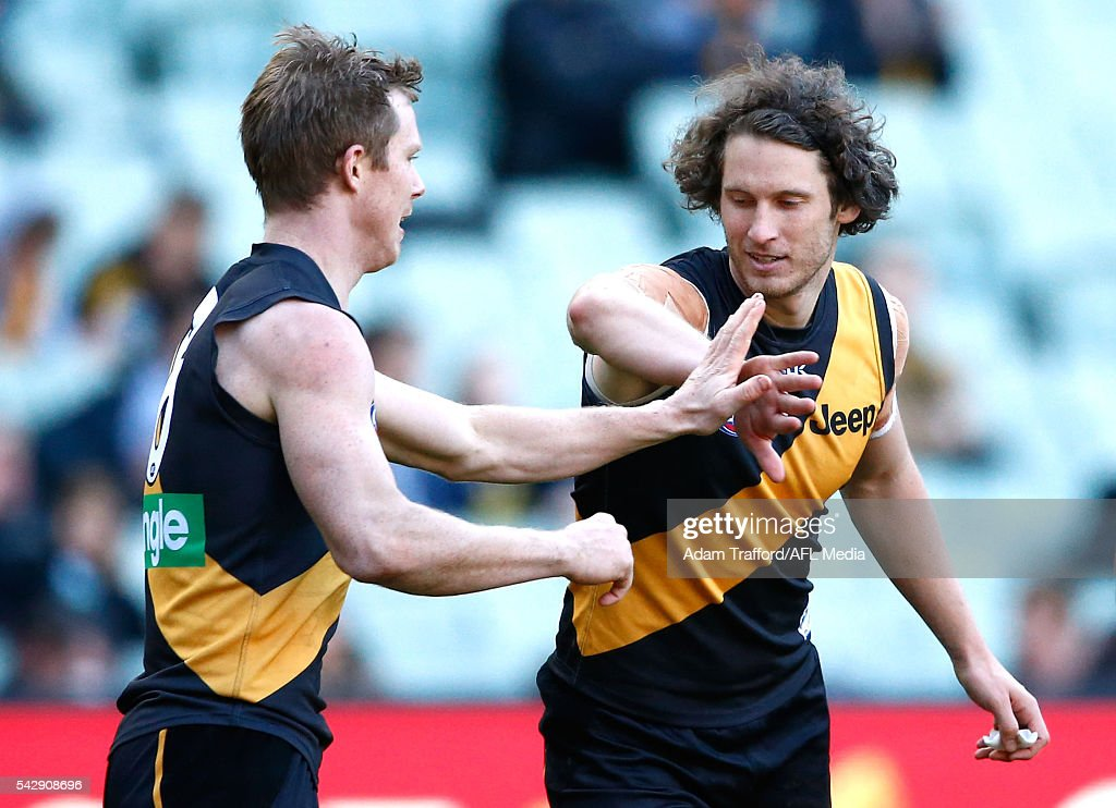 <a gi-track='captionPersonalityLinkClicked' href=/galleries/search?phrase=Jack+Riewoldt&family=editorial&specificpeople=2327975 ng-click='$event.stopPropagation()'>Jack Riewoldt</a> of the Tigers celebrates a goal with Ty Vickery of the Tigers during the 2016 AFL Round 14 match between the Richmond Tigers and the Brisbane Lions at the Melbourne Cricket Ground on June 25, 2016 in Melbourne, Australia.