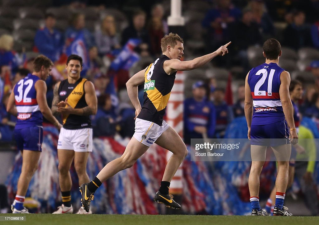 <a gi-track='captionPersonalityLinkClicked' href=/galleries/search?phrase=Jack+Riewoldt&family=editorial&specificpeople=2327975 ng-click='$event.stopPropagation()'>Jack Riewoldt</a> of the Tigers celebrates after kicking a goal during the round 13 AFL match between the Western Bulldogs and the Richmond Tigers at Etihad Stadium on June 22, 2013 in Melbourne, Australia.