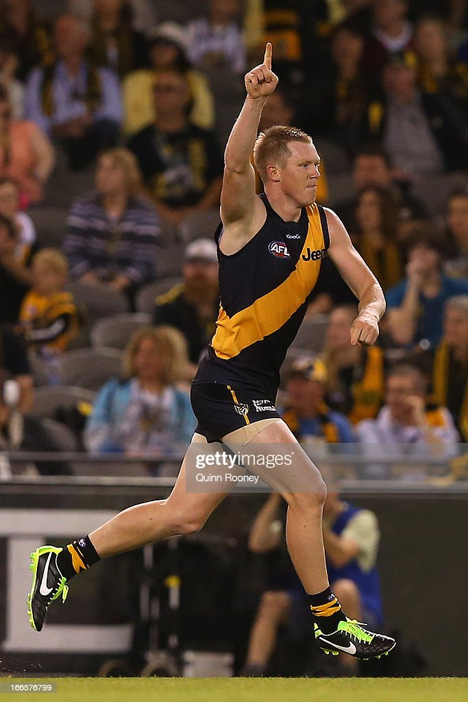 <a gi-track='captionPersonalityLinkClicked' href=/galleries/search?phrase=Jack+Riewoldt&family=editorial&specificpeople=2327975 ng-click='$event.stopPropagation()'>Jack Riewoldt</a> of the Tigers celebrates kicking a goal during the round three AFL match between the Richmond Tigers and the Western Bulldogs at Etihad Stadium on April 14, 2013 in Melbourne, Australia.