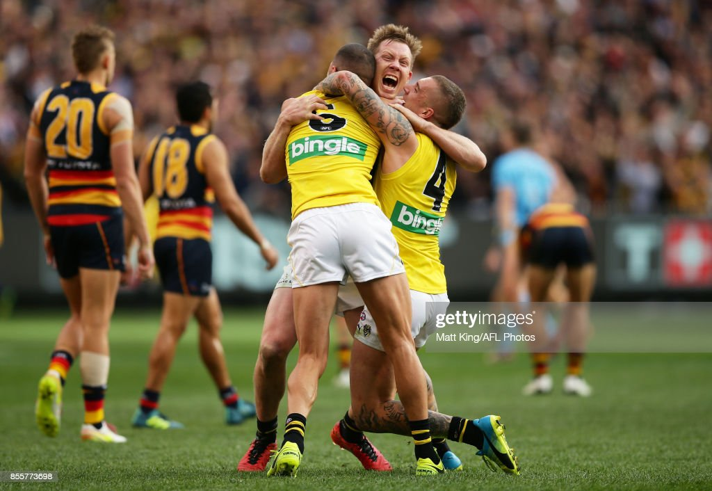 Jack Riewoldt of the Tigers (C) celebrates victory with team mates Shaun Grigg (L) and Dustin Martin (R) at the final siren during the 2017 AFL Grand Final match between the Adelaide Crows and the Richmond Tigers at Melbourne Cricket Ground on September 30, 2017 in Melbourne, Australia.