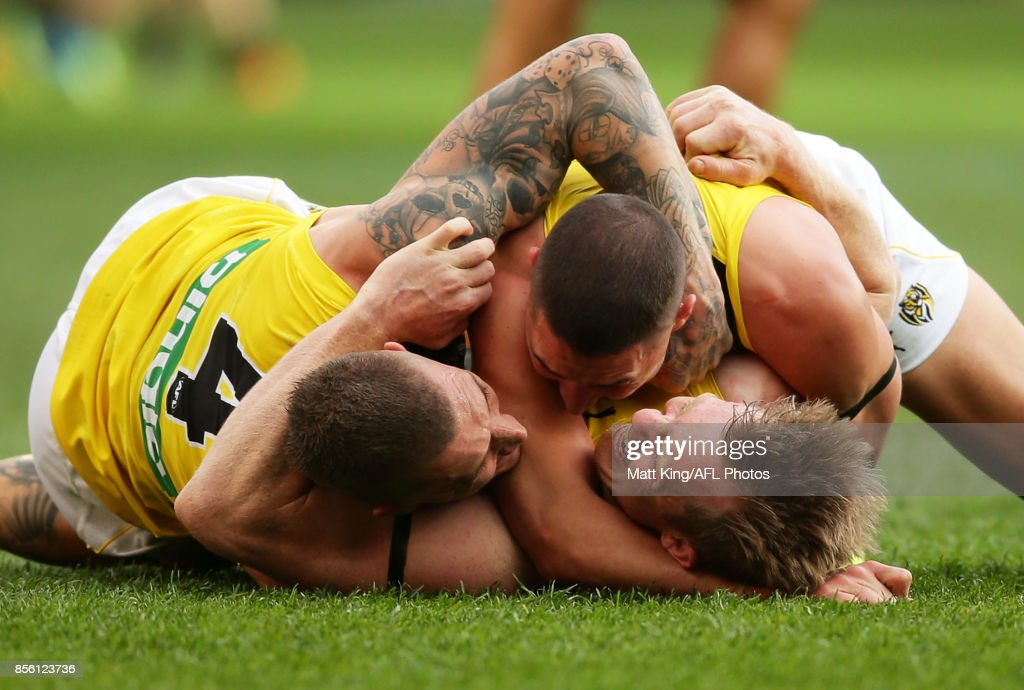 Jack Riewoldt of the Tigers (C) celebrates victory with team mates Shaun Grigg (R) and Dustin Martin (L) at the final siren during the 2017 AFL Grand Final match between the Adelaide Crows and the Richmond Tigers at Melbourne Cricket Ground on September 30, 2017 in Melbourne, Australia.