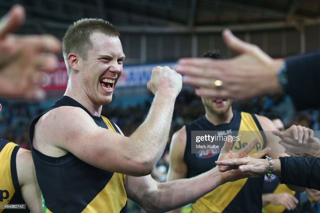 Jack Riewoldt of the Tigers celebrates with the crowd after victory during the round 23 AFL match between the Sydney Swans and the Richmond Tigers at...