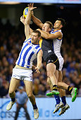 Jack Riewoldt of the Tigers competes for a mark with Lachlan Hansen and Robbie Tarrant of the Kangaroos during the round 23 AFL match between the...