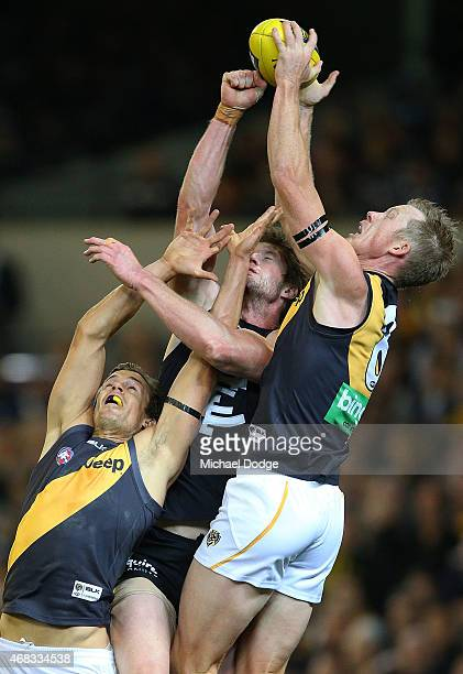 Jack Riewoldt of the Tigers competes for the ball against Sam Rowe of the Blues and next to teamate Brett Deledio of the Tigers during the round one...