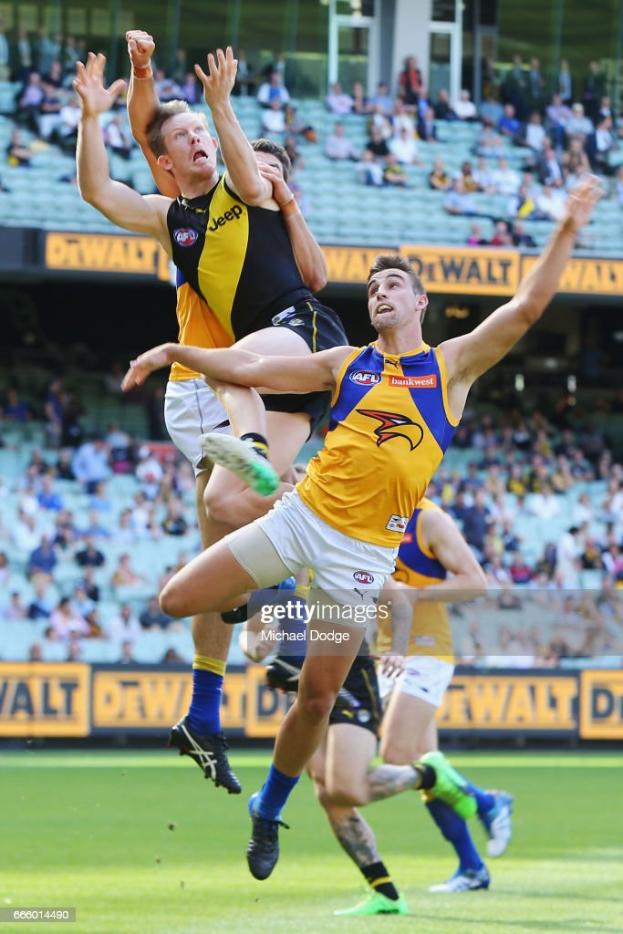 Jack Riewoldt of the Tigers competes for the ball over Tom Barrass of the Eagles during the round three AFL match between the Richmond Tigers and the West Coast Eagles at Melbourne Cricket Ground on April 8, 2017 in Melbourne, Australia.