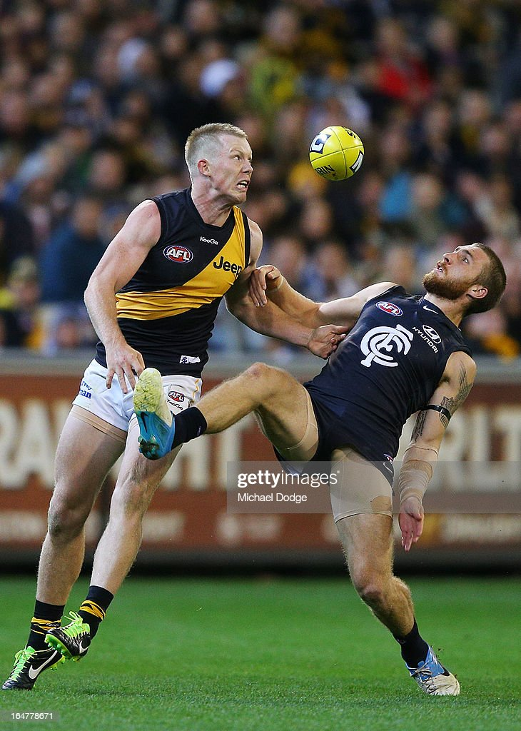 A Jack Riewoldt (L) of the Tigers contests for the ball against Zac Tuohy of the Blues during the round one AFL match between the Carlton Blues and the Richmond Tigers at Melbourne Cricket Ground on March 28, 2013 in Melbourne, Australia.