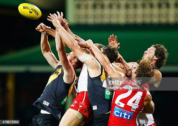 Jack Riewoldt of the Tigers is challenged from behind during the round 13 AFL match between the Sydney Swans and the Richmond Tigers at SCG on June...