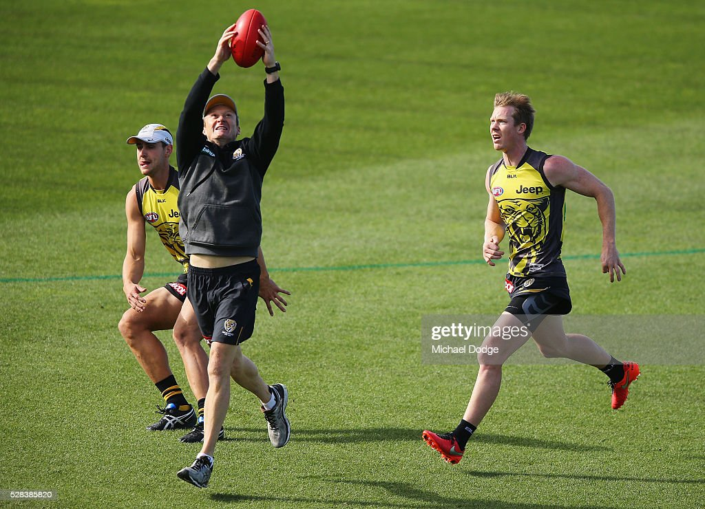 <a gi-track='captionPersonalityLinkClicked' href=/galleries/search?phrase=Jack+Riewoldt&family=editorial&specificpeople=2327975 ng-click='$event.stopPropagation()'>Jack Riewoldt</a> of the Tigers is intercepted by a trainer during a Richmond Tigers AFL training session at Punt Road Oval on May 5, 2016 in Melbourne, Australia.