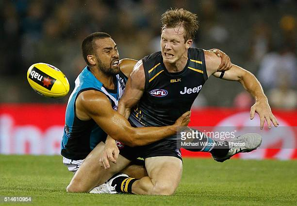 Jack Riewoldt of the Tigers is tackled by Alipate Carlile of the Power during the 2016 NAB Challenge match between the Richmond Tigers and Port...