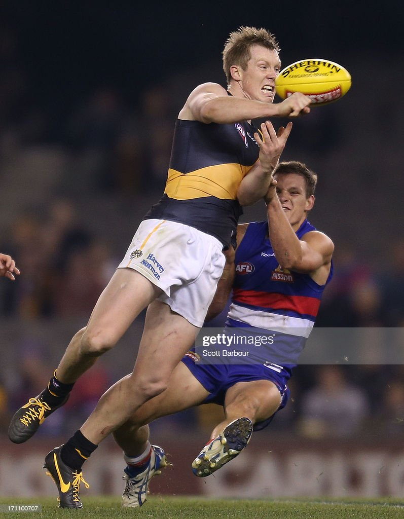 <a gi-track='captionPersonalityLinkClicked' href=/galleries/search?phrase=Jack+Riewoldt&family=editorial&specificpeople=2327975 ng-click='$event.stopPropagation()'>Jack Riewoldt</a> of the Tigers is tackled during the round 13 AFL match between the Western Bulldogs and the Richmond Tigers at Etihad Stadium on June 22, 2013 in Melbourne, Australia.