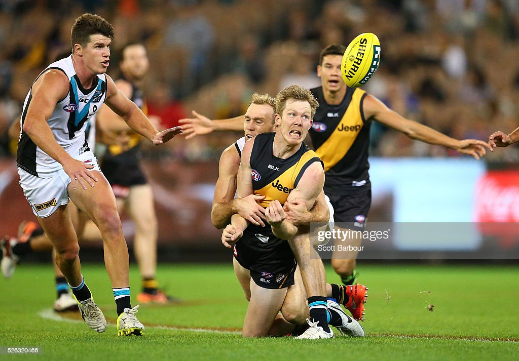 <a gi-track='captionPersonalityLinkClicked' href=/galleries/search?phrase=Jack+Riewoldt&family=editorial&specificpeople=2327975 ng-click='$event.stopPropagation()'>Jack Riewoldt</a> of the Tigers is tackled during the round six AFL match between the Richmond Tigers and the Port Adelaide Power at Melbourne Cricket Ground on April 30, 2016 in Melbourne, Australia.