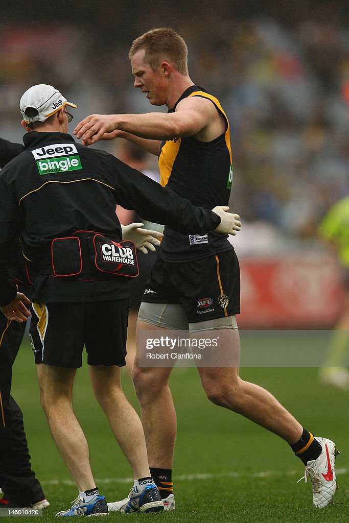 <a gi-track='captionPersonalityLinkClicked' href=/galleries/search?phrase=Jack+Riewoldt&family=editorial&specificpeople=2327975 ng-click='$event.stopPropagation()'>Jack Riewoldt</a> of the Tigers is taken from the ground with an injury during the round 11 AFL match between the Richmond Tigers and the Fremantle Dockers at Melbourne Cricket Ground on June 9, 2012 in Melbourne, Australia.