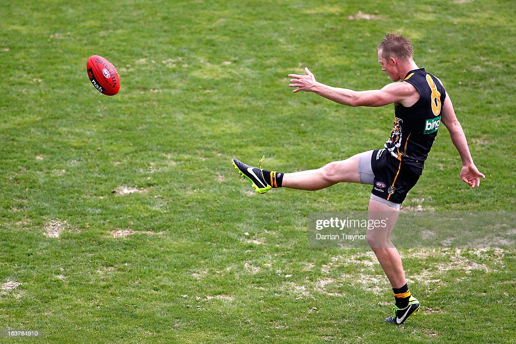Jack Riewoldt of the Tigers kicks for goal during the AFL practice match between the Richmond Tigers and the Western Bulldogs at Visy Park on March 16, 2013 in Melbourne, Australia.