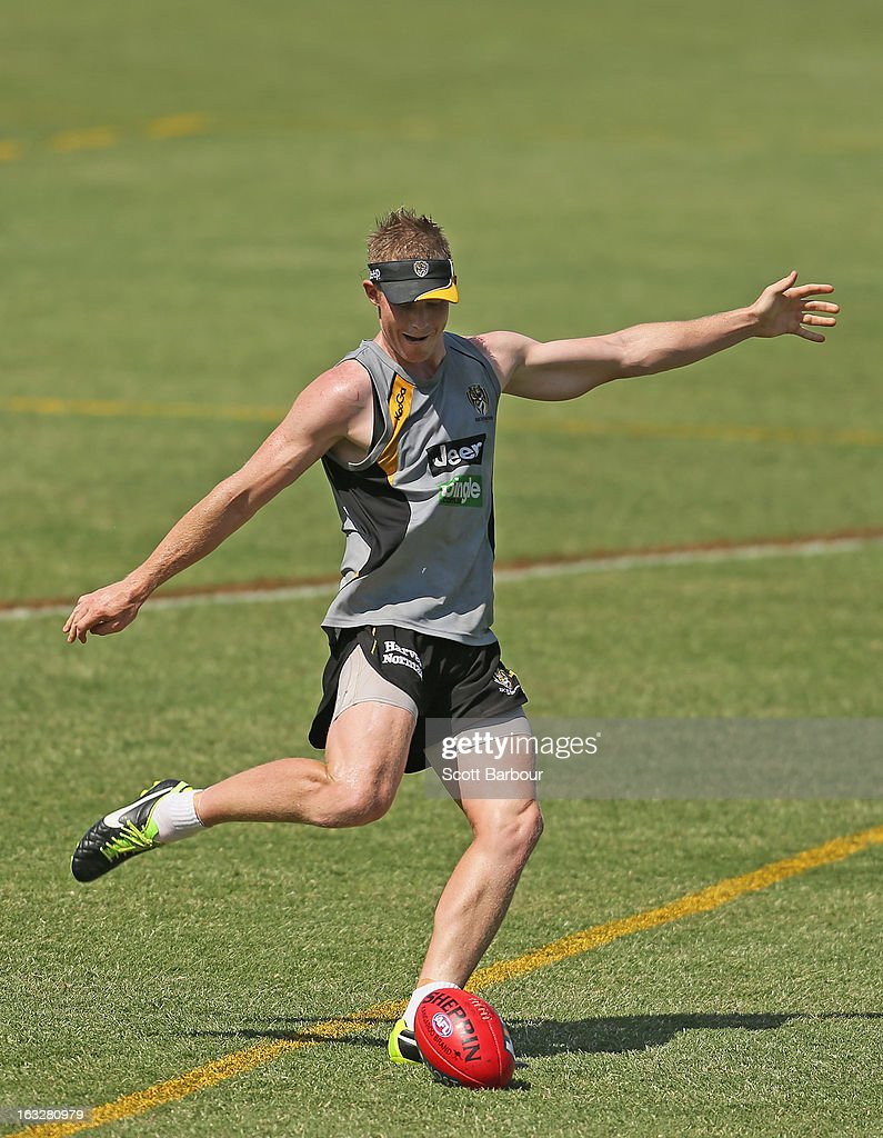 <a gi-track='captionPersonalityLinkClicked' href=/galleries/search?phrase=Jack+Riewoldt&family=editorial&specificpeople=2327975 ng-click='$event.stopPropagation()'>Jack Riewoldt</a> of the Tigers kicks the ball during a Richmond Tigers AFL training session at ME Bank Centre on March 7, 2013 in Melbourne, Australia.
