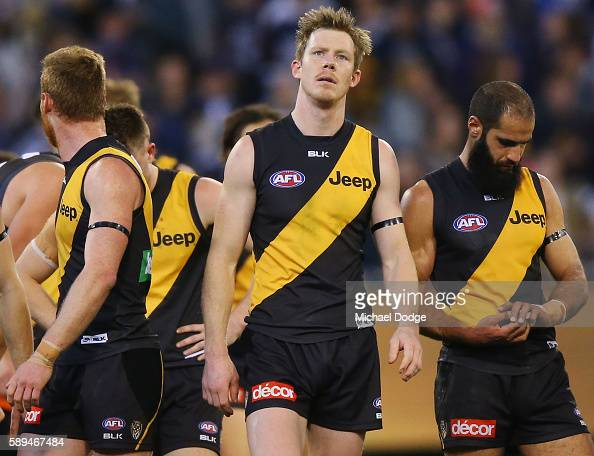 Jack Riewoldt of the Tigers looks dejected as they walk off after defeat during the round 21 AFL match between the Richmond Tigers and the Geelong...
