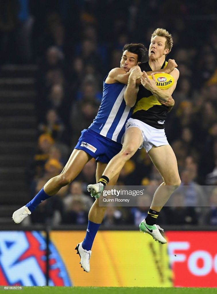 Jack Riewoldt of the Tigers marks infront of Robbie Tarrant of the Kangaroos during the round 11 AFL match between the North Melbourne Kangaroos and the Richmond Tigers at Etihad Stadium on June 3, 2017 in Melbourne, Australia.