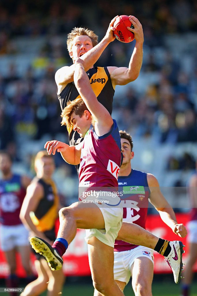 Jack Riewoldt of the Tigers marks over the top of Ben Keays of the Lions during the round 14 AFL match between the Richmond Tigers and the Brisbane...