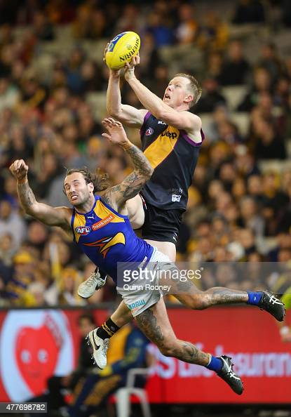 Jack Riewoldt of the Tigers marks over the top of Chris Masten of the Eagles during the round 12 AFL match between the Richmond Tigers and the West...
