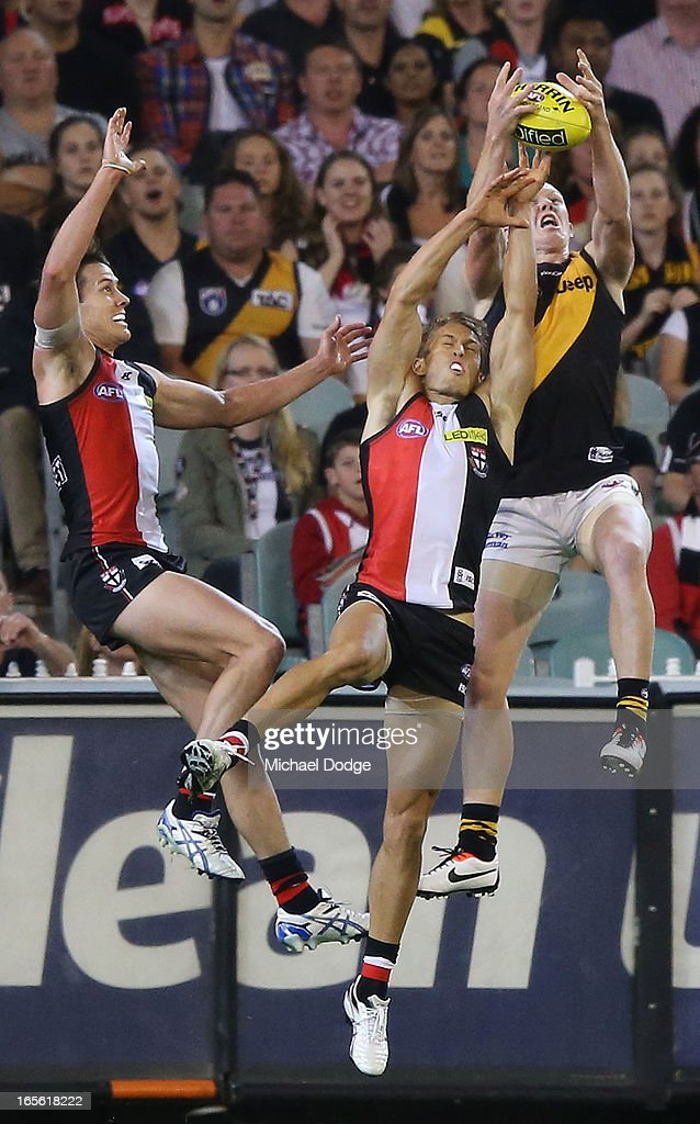 <a gi-track='captionPersonalityLinkClicked' href=/galleries/search?phrase=Jack+Riewoldt&family=editorial&specificpeople=2327975 ng-click='$event.stopPropagation()'>Jack Riewoldt</a> (R) of the Tigers marks the ball against Sean Dempster of the Saints during the round two AFL match between the St Kilda Saints and the Richmond Tigers at Melbourne Cricket Ground on April 5, 2013 in Melbourne, Australia.