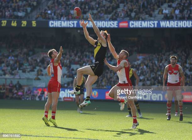 Jack Riewoldt of the Tigers marks the ball during the round 13 AFL match between the Richmond Tigers and the Sydney Swans at Melbourne Cricket Ground...