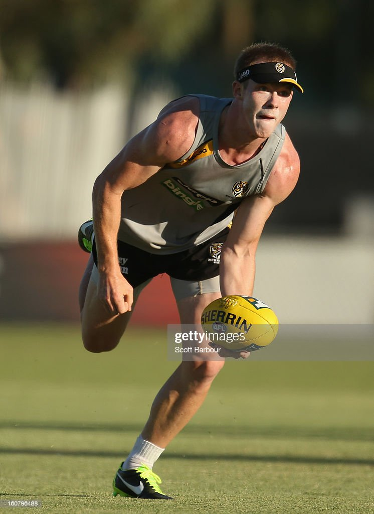 <a gi-track='captionPersonalityLinkClicked' href=/galleries/search?phrase=Jack+Riewoldt&family=editorial&specificpeople=2327975 ng-click='$event.stopPropagation()'>Jack Riewoldt</a> of the Tigers passes the ball during a Richmond Tigers AFL training session ahead of the AFL exhibition match between the Richmond Tigers and the Indigenous All Stars at Traeger Park on February 6, 2013 in Alice Springs, Australia.