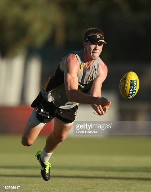 Jack Riewoldt of the Tigers passes the ball during a Richmond Tigers AFL training session ahead of the AFL exhibition match between the Richmond...