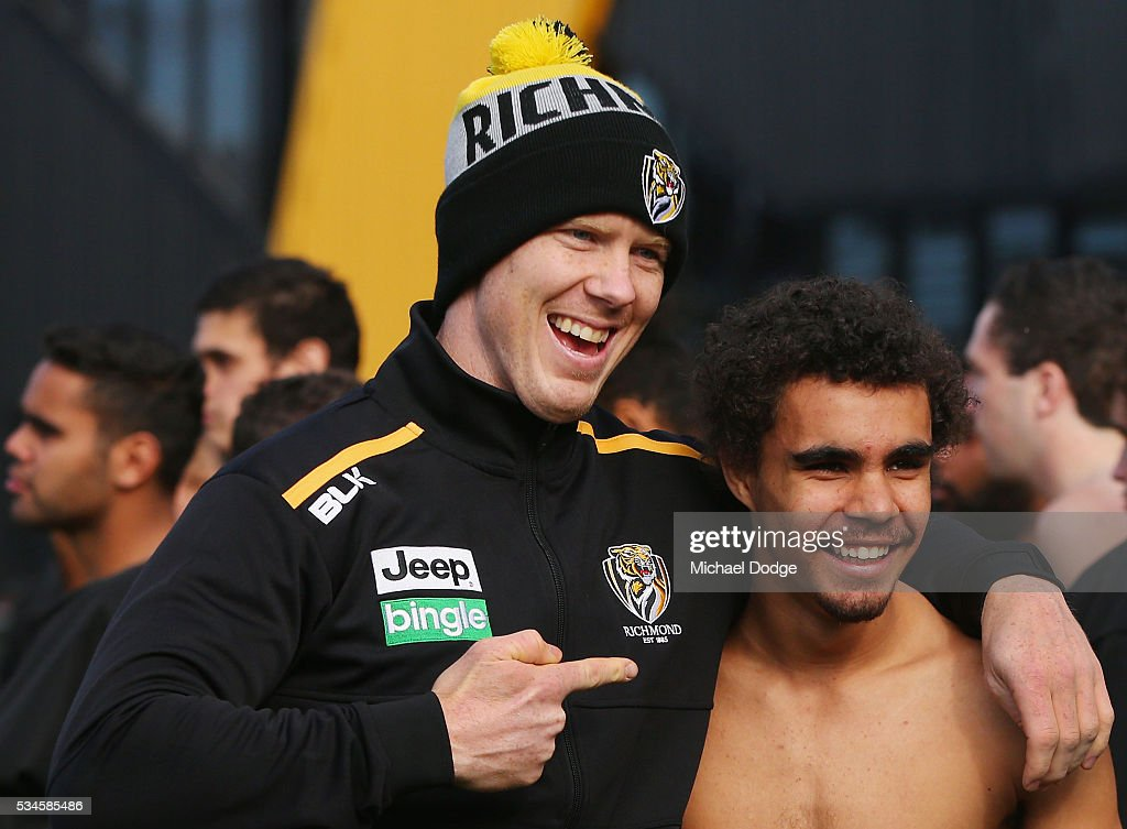 <a gi-track='captionPersonalityLinkClicked' href=/galleries/search?phrase=Jack+Riewoldt&family=editorial&specificpeople=2327975 ng-click='$event.stopPropagation()'>Jack Riewoldt</a> of the Tigers poses with a young Indigenous representative after he performed a traditional war cry during a Richmond Tigers AFL training session at ME Bank Centre on May 27, 2016 in Melbourne, Australia. The AFL celebrates Indigenous Round this weekend.