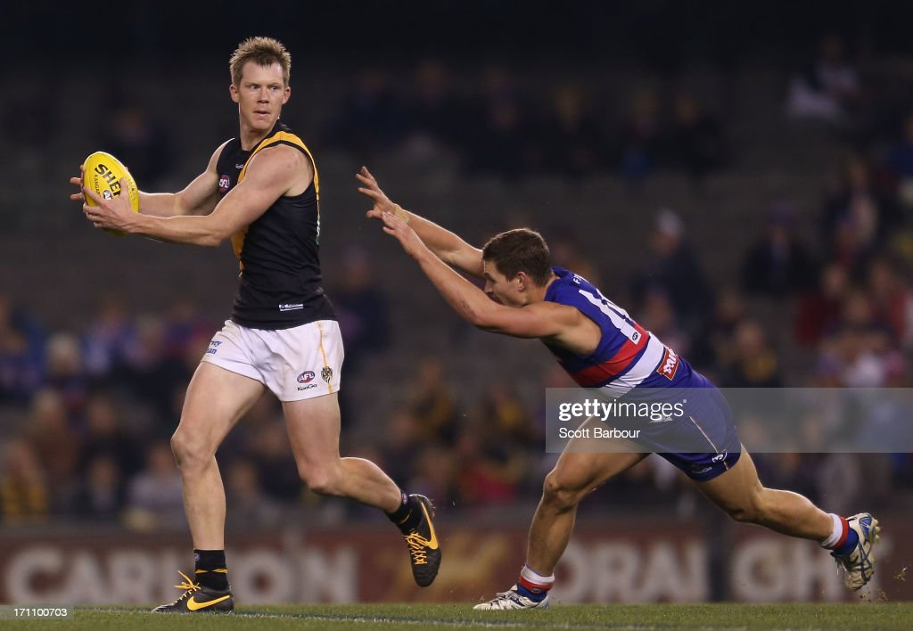 Jack Riewoldt of the Tigers runs with the ball during the round 13 AFL match between the Western Bulldogs and the Richmond Tigers at Etihad Stadium on June 22, 2013 in Melbourne, Australia.