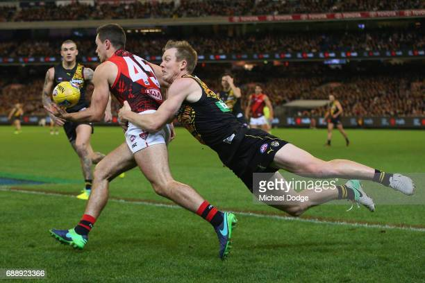 Jack Riewoldt of the Tigers tackles Conor McKenna of the Bombers during the round 10 AFL match between the Richmond Tigers and the Essendon Bombers...