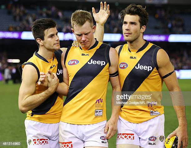 Jack Riewoldt of the Tigers walks off in tears with Trent Cotchin and Alex Rance during the round 16 AFL match between the St Kilda Saints and the...