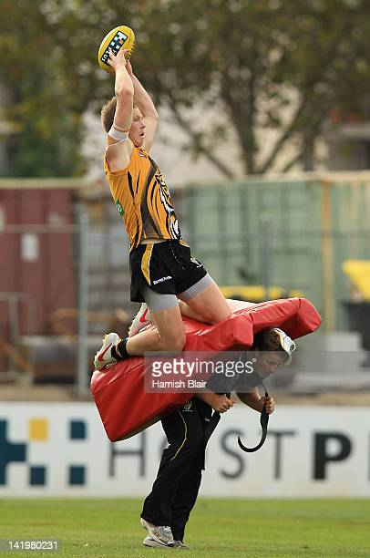 Jack Riewoldt takes a mark over coach Damien Hardwick during a Richmond Tigers AFL training session at ME Bank Centre on March 28 2012 in Melbourne...