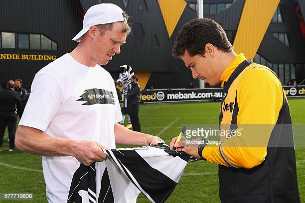 Jack Riewolt of the Tigers comes in on his day off to meet Hernanes of Juventus during a Richmond Tigers AFL and Juventus FC media opportunity at...
